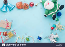creative flat lay of ornaments and gift boxes on pastel