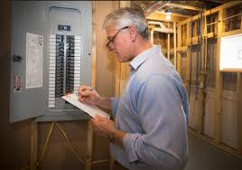 home inspector checks breaker box
