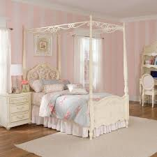 bedroom white carving wood canopy bed for teen girls next to