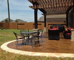 this rustic outdoor patio was designed and constructed by the