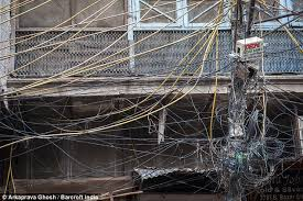 power cables in old delhi dangle perilously close to the residents