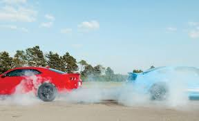 car and driver mustang vs camaro 2012 chevrolet camaro zl1 vs ford mustang shelby gt500 comparison