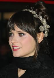 black hairstyles with bun and bangs zooey deschanel long hairstyle braided bun with bangs pretty