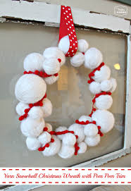 yarn snowball christmas wreath and nine other awesome wreath ideas