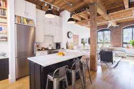 Big Loft by Ansonia Loft With Exposed Wood Beams And Big Brick Framed Windows
