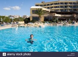 the swimming pool at the venus beach hotel pafos cyprus stock