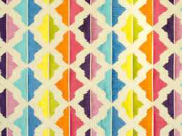 multi colored embroidered fabric caribbean islands tropical vibes