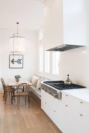 fresh minimal and clean modern dining nook in a white kitchen