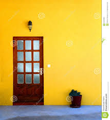 door on yellow house background stock photo image 64963862