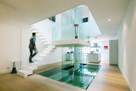 Urban House Design Enhanced By Decorating With Glass And Bright - Modern house design interior