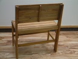 brown teak shower bench with backrest and shelf on brown wooden