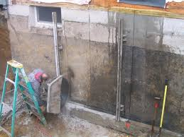 cutting a door in a concrete foundation