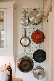 using a pegboard for holding pots and pans nice idea for small