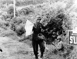 Soldier With Flag German Soldier Carrying A White Flag Surrenders To American Troops