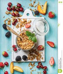 healthy breakfast ingredients oat granola in open glass jar