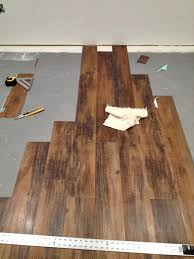 Vinegar For Laminate Floors Endearing Dark Laminate Floor With Black Sofa And Table Glass Also
