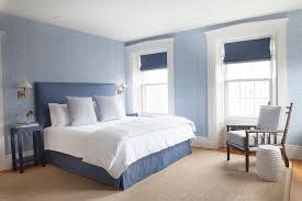 blue on blue bedroom with blue nightstands transitional bedroom