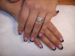 black tips with pink base and white flowers nail design