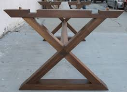 minimalist x trestle table in black walnut with extensions from