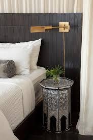 black moroccan bedroom with octagon moroccan bedside table