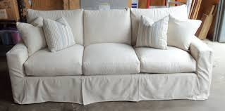 How To Make A Slipcover For A Couch Living Room Cozy Berber Carpet With Swing Floor Lamp And White