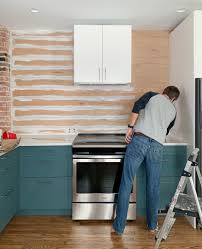 shiplap kitchen backsplash with cabinets installing a 31 paneled wall treatment beginners can do