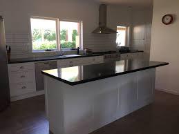 granite countertop white kitchen cabinets with glaze diplomat
