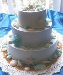 wedding cakes pictures seashell wedding cake blue trim