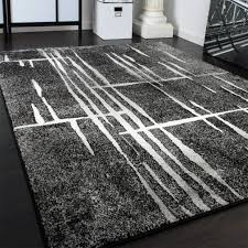 steinwand wohnzimmer reinigen teppich für wohnzimmer glamouros designer kariert modern trendig