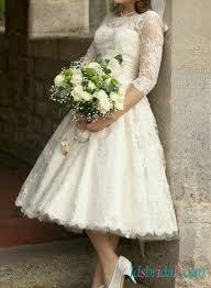 1950s retro tea length ivory lace sleeved wedding dress vintage