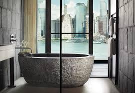 riverhouse 2 000 sq ft 2 rooms 1 hotel brooklyn bridge oversized stone soaking tub in master bedroom with manhattan skyline views