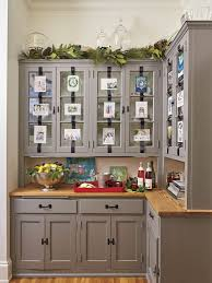 top of kitchen cabinet greenery 50 ways to decorate with fresh greenery southern