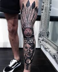 grey ink native american tattoo on left leg by joe carpenter