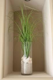 best ideas about beach theme bathroom pinterest beach grass anchored sand and shells idea for wall alcoves down hallway