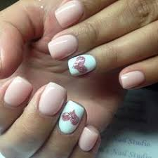 pink nails peach color nails with silver and white stripes