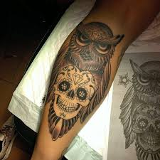 skull and owl tattoo on back leg by partizan
