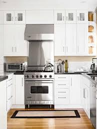 white kitchen cabinets with black countertops design ideas