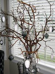 the branch decorated with ornaments add some lights