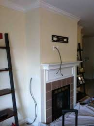 mount tv above brick fireplace hide wires american hwy