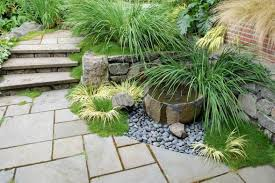 small garden landscaping with concrete steps and pebbles house
