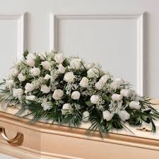 cushion of white funeral flowers sanchoflor s l