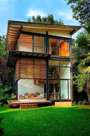 wooden house with unusual shape and open plan interior