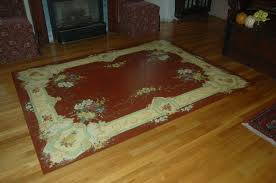 painted rug on a wood floor dining room boston by