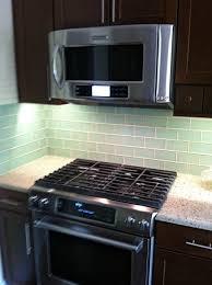 glass subway tile backsplash with dark cabinets home design ideas