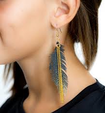 one side feather earring gold sparkle feather earrings andrea s notebook