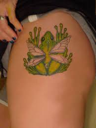 green ink frog with wings on left thigh