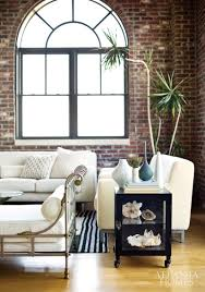 contrast between exposed brick and white couches home sweet home