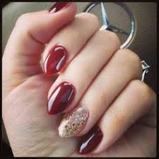oxblood nails with crystal glitter accent nail knucke ring
