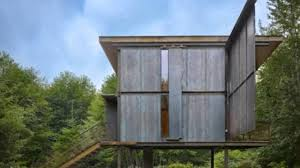 steel clad 350 sq ft modern cabin on stilts with shutters youtube
