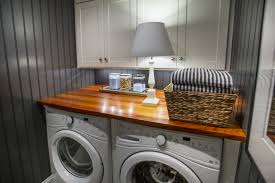 mesmerizing laundry room table design featuring white wooden
